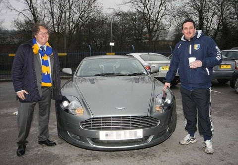 MANSFIELD Town chairman John Radford gave his Aston Martin car to manager Paul Cox